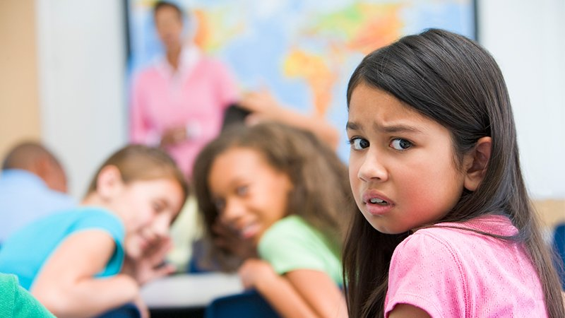 girl being laughed at in the classroom